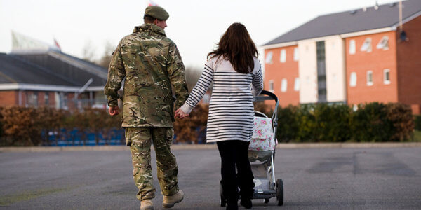 soldier and wife walking away